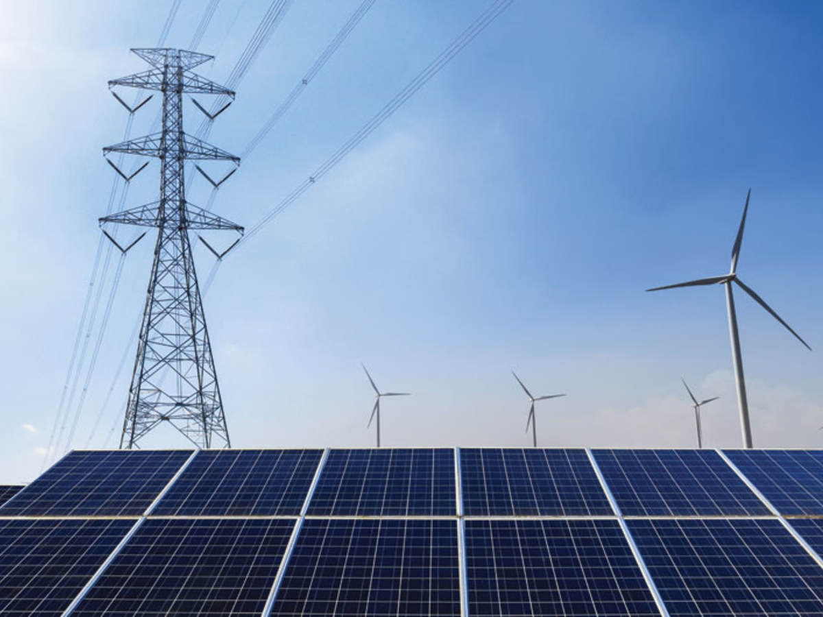 Power line, solar panels and wind turbines against blue sky
