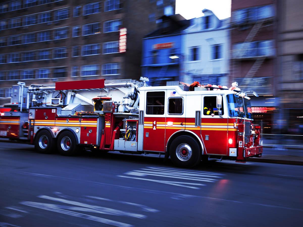 fire truck driving down a street