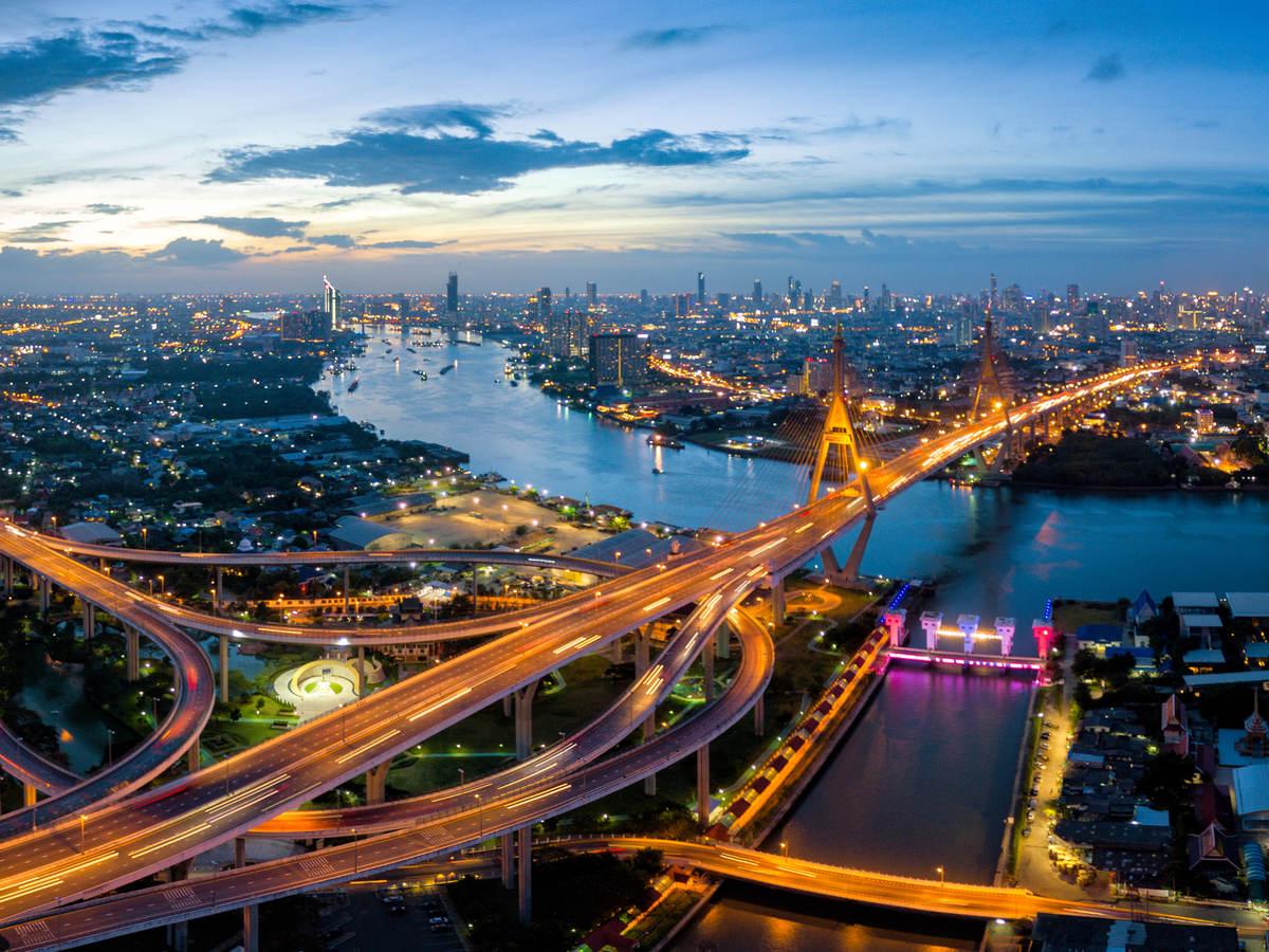 Aerial view of Bhumibol suspension bridge cross over Chao Phraya River in Bangkok city.