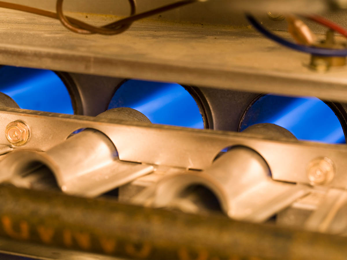 Close up of gas burning residential furnace jets