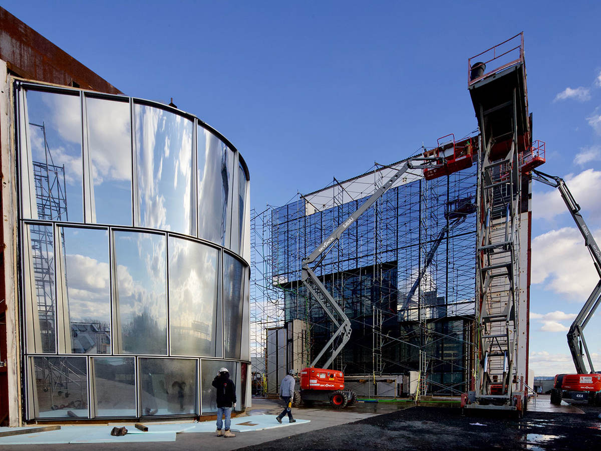 photo of a glass building under construction