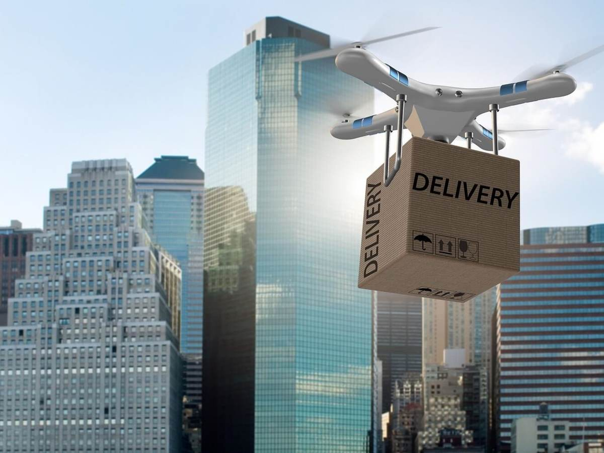 Drone attempts to deliver package in city landscape.