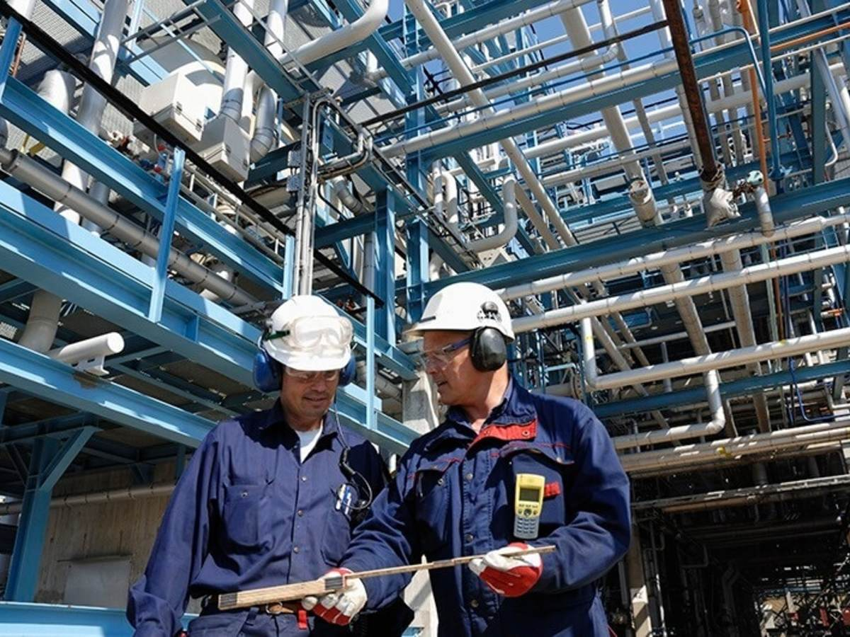 two workers at oil refinery