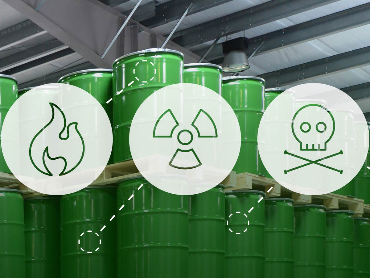 Stacks of barrels containing chemicals superimposed with safety hazard icons for European classification and labelling