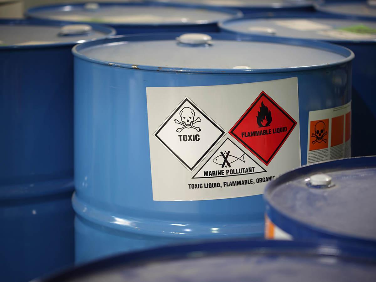 Blue barrels marked with Hazard Communication labeling