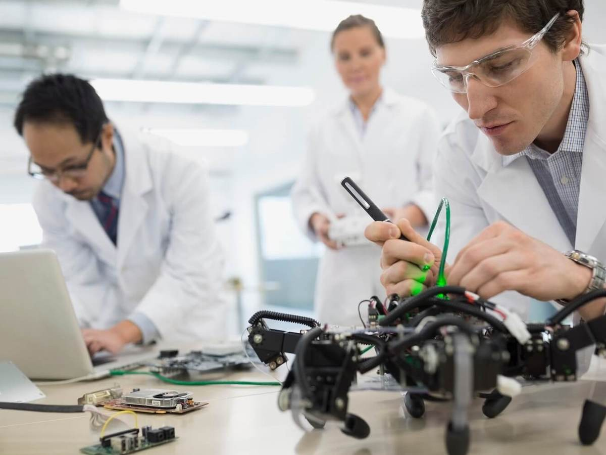 Laboratory technicians examine the battery safety packs of a drone.