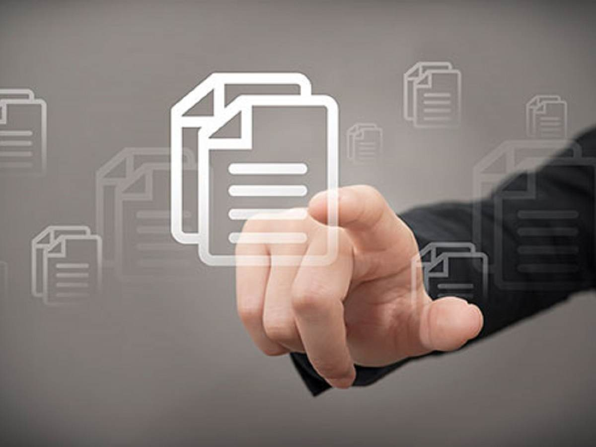 Man's hand with finger extended, pointing to SDS document file icon