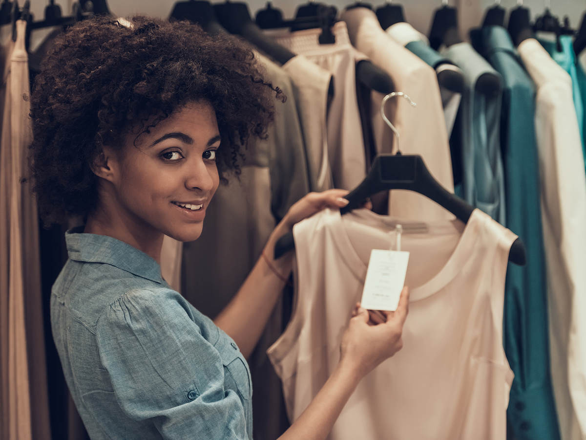 Woman looking at a tag on a blouse