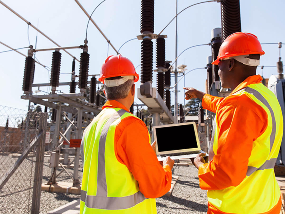power workers on laptop