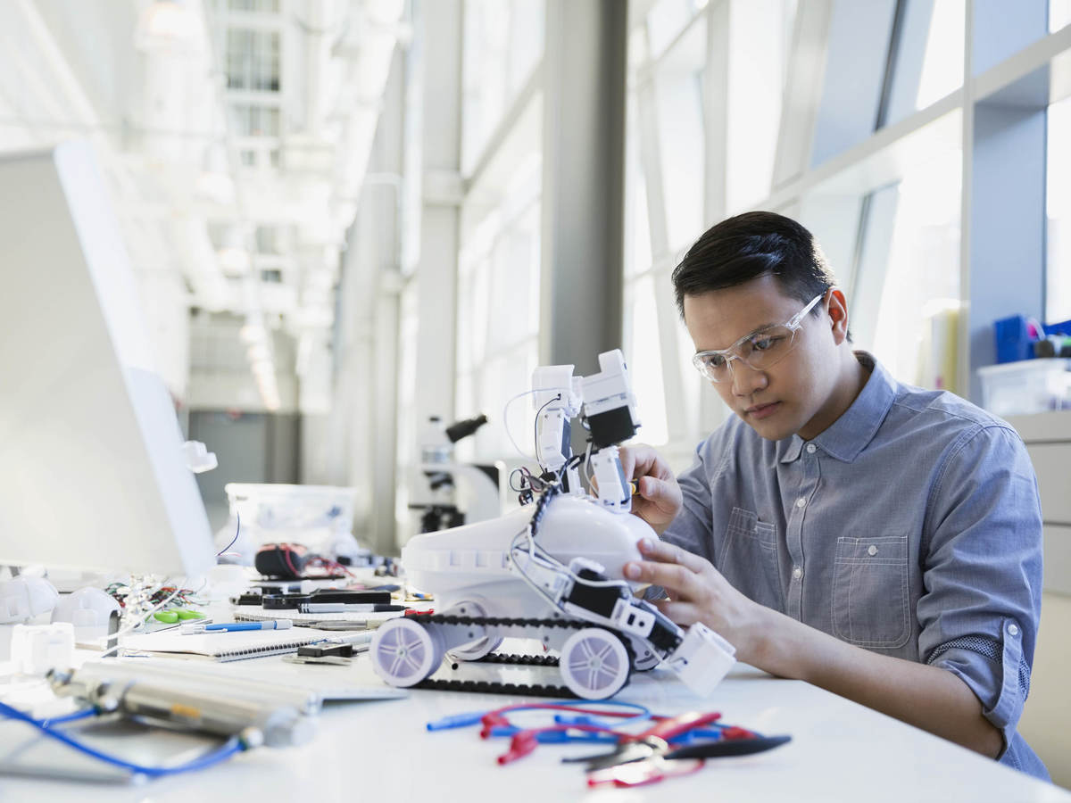 Worker working on a small robot