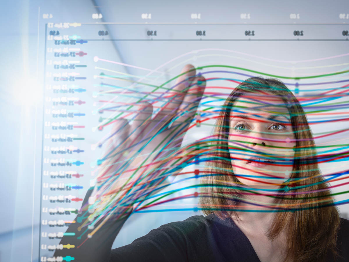Woman looking at UL Product Lens data display