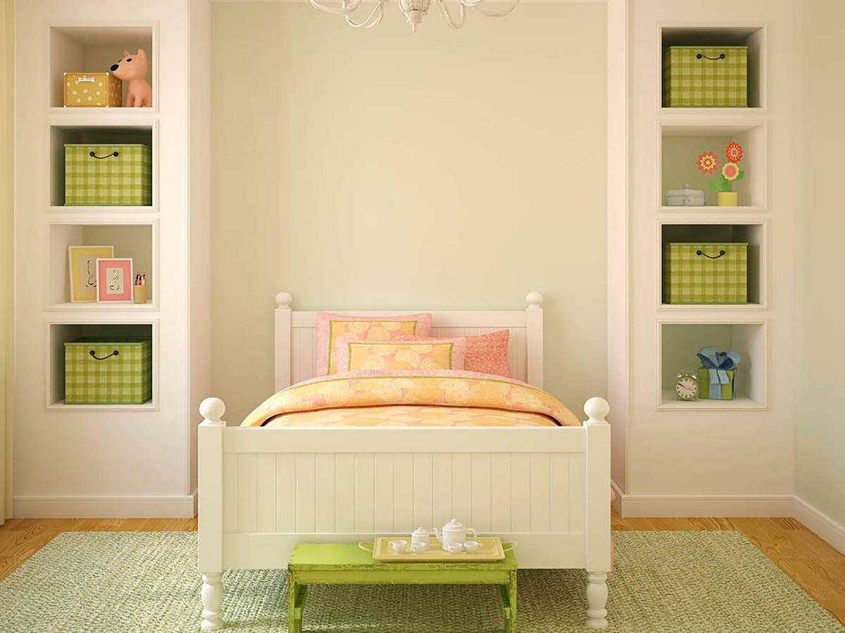 Child's bedroom with bed and bookshelves
