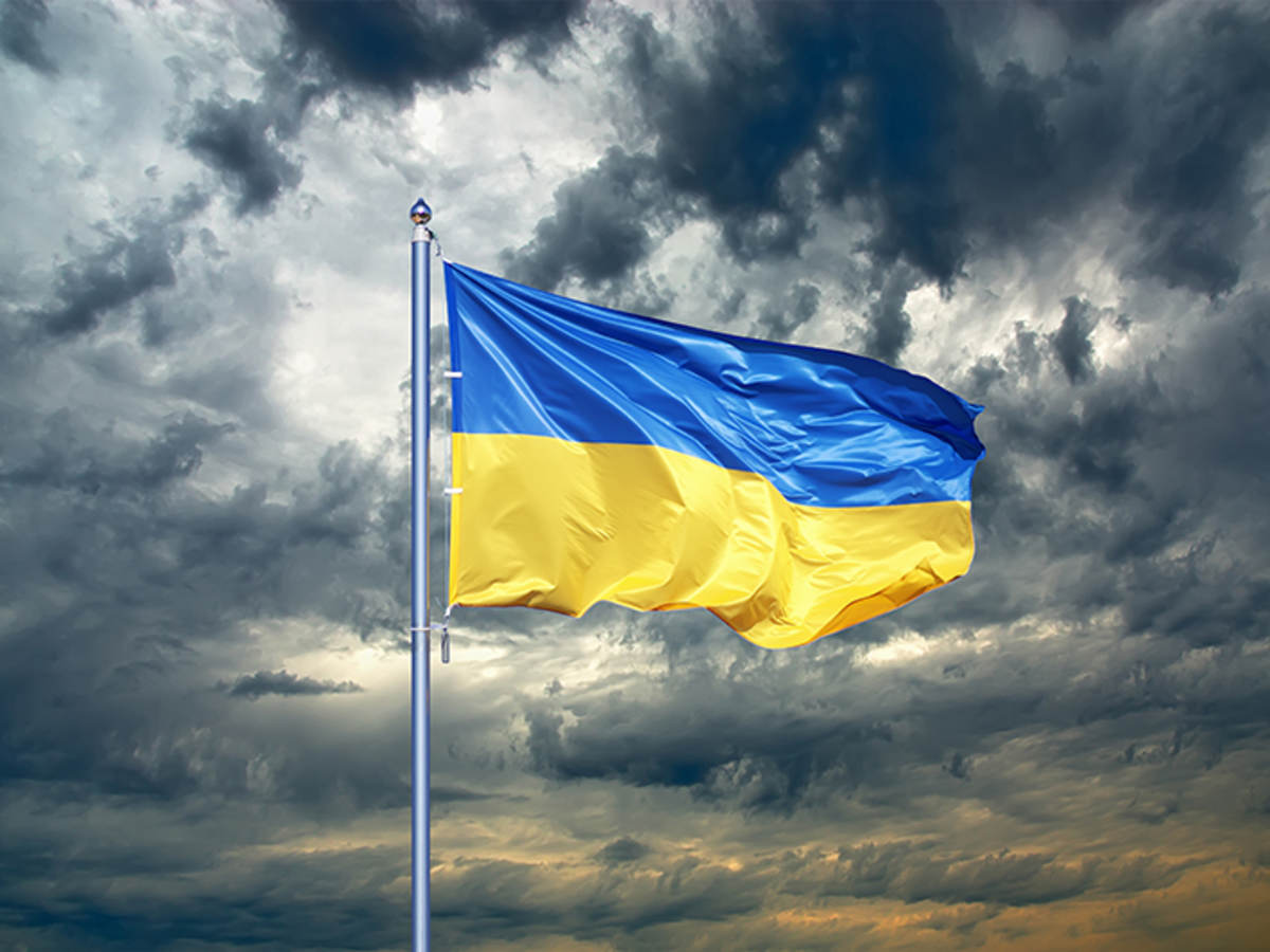 Ukraine flag against stormy sky