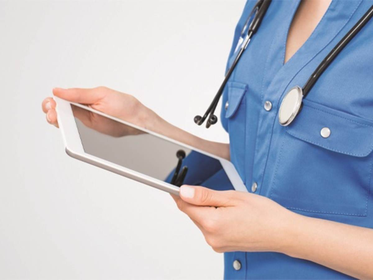 Photo of a nurse using software on a tablet