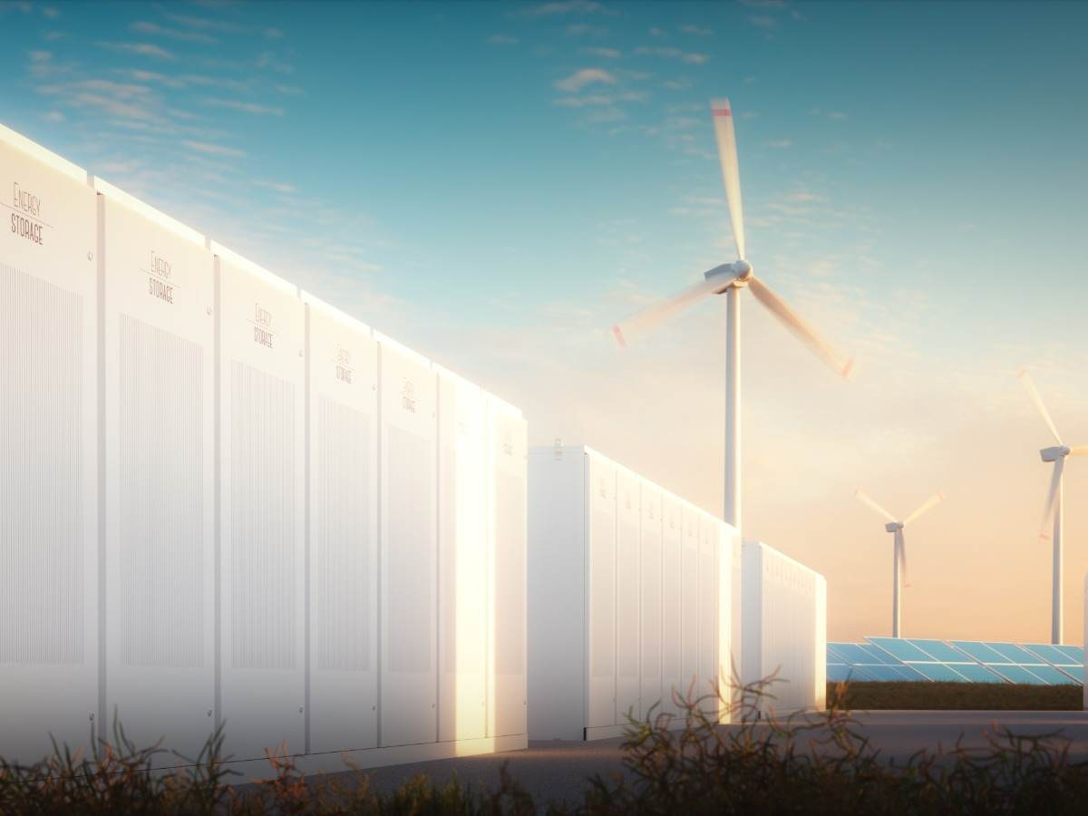 Large scale energy storage with solar panels and wind turbines in background