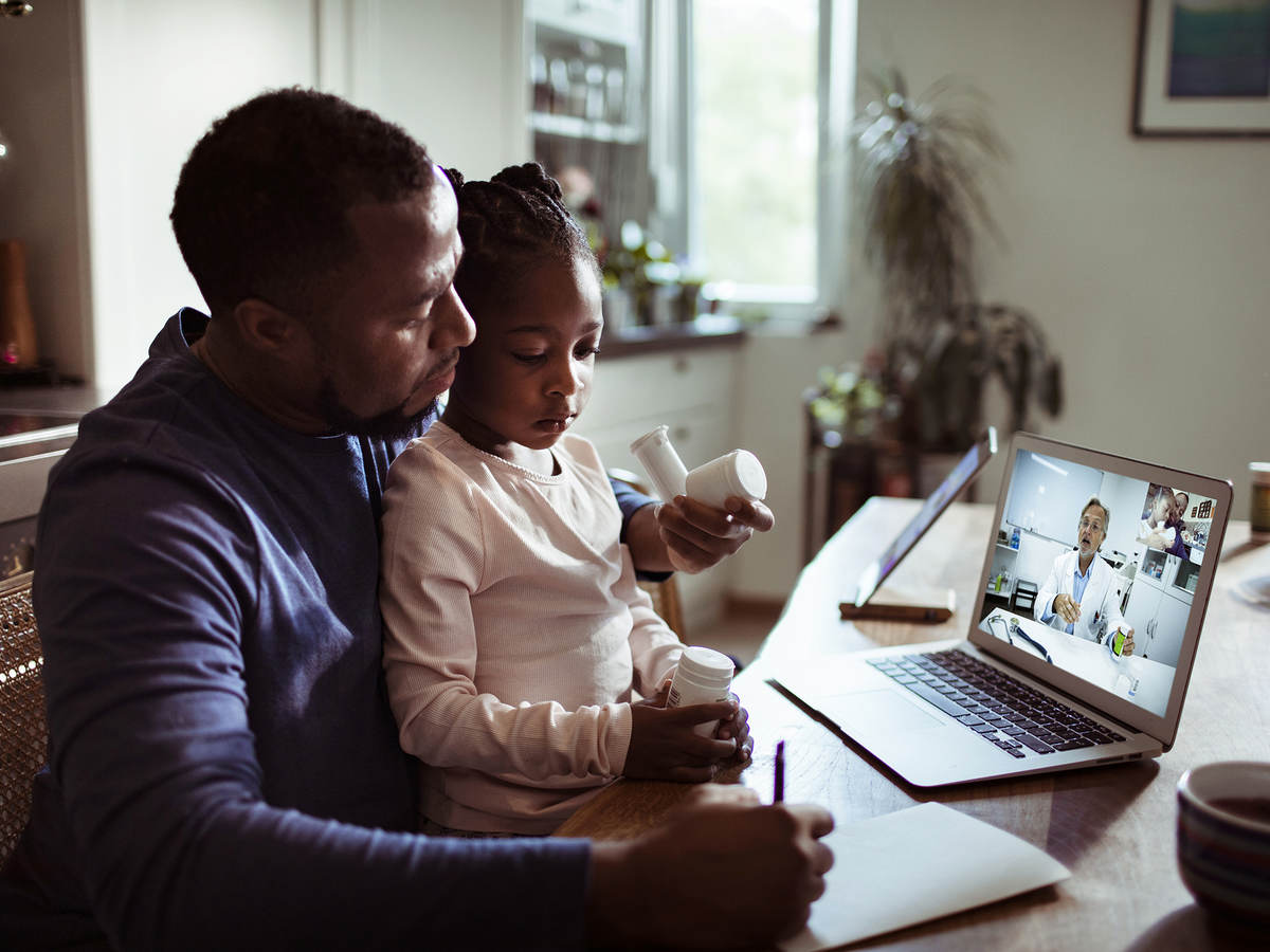 Father and daughter online with dr