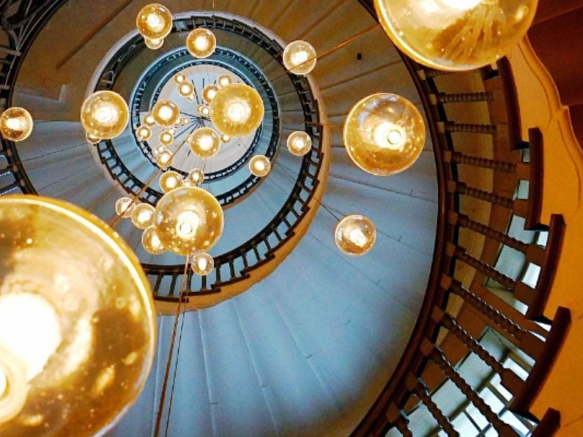 Chandelier hanging from spiral staircase