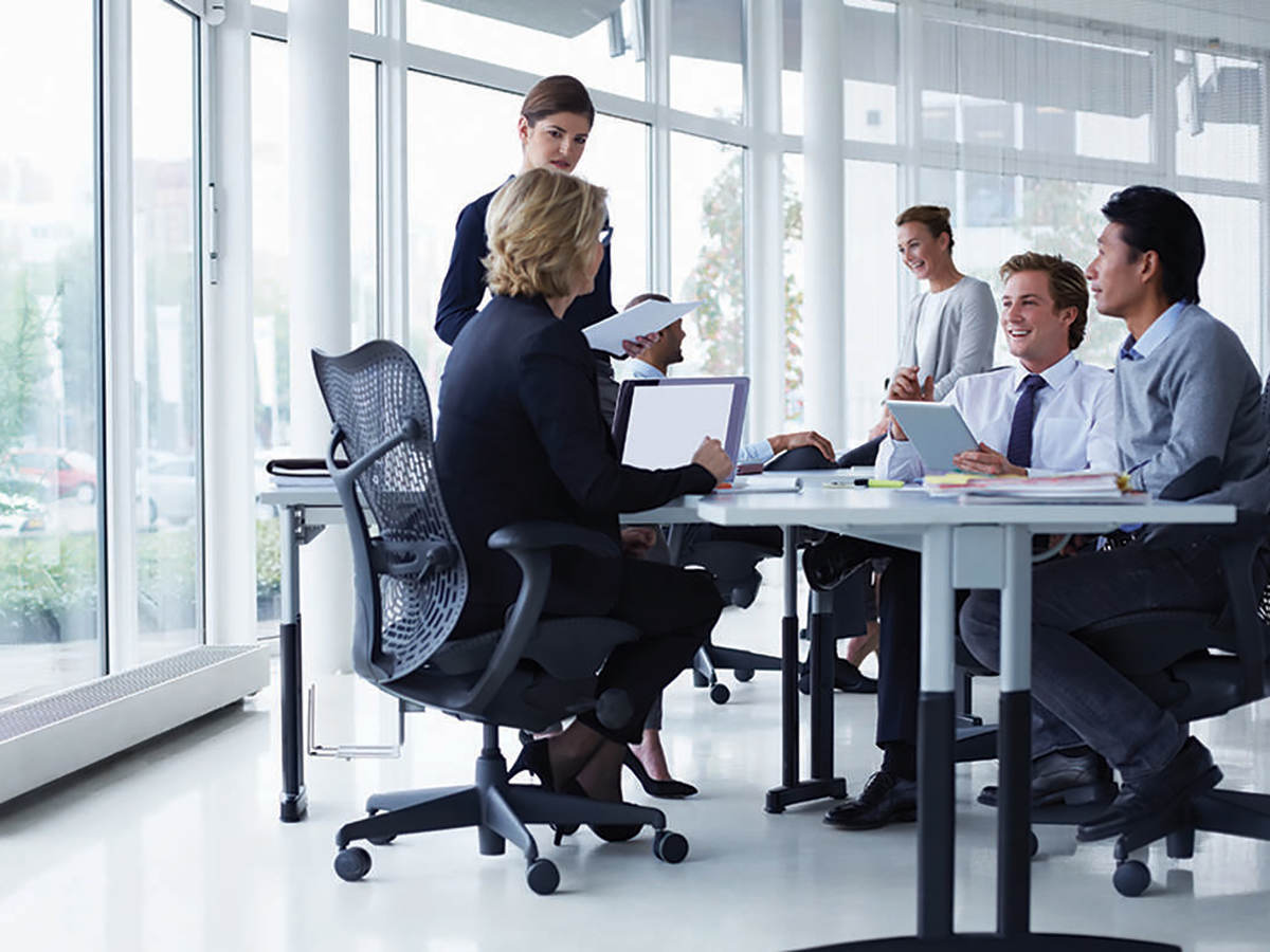 Business people having a conversation in a conference room