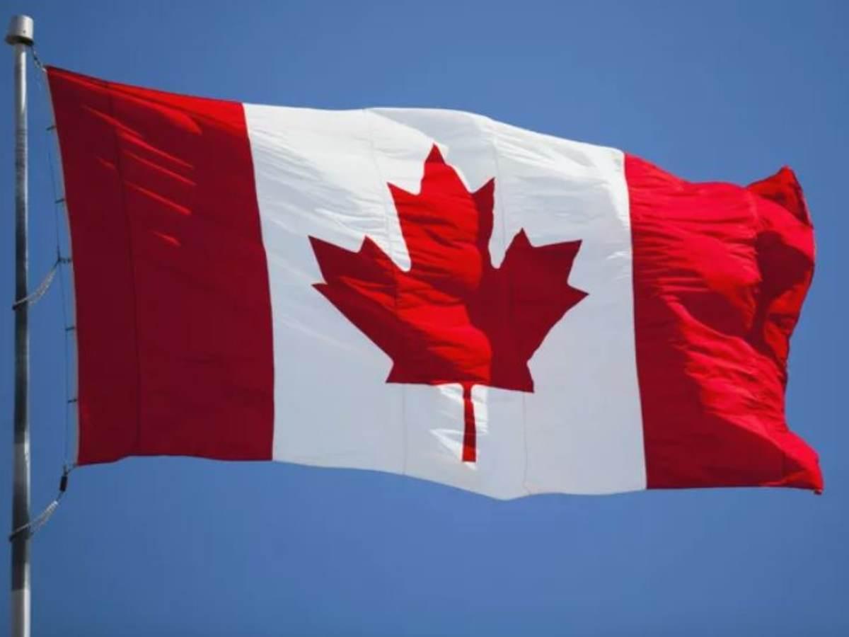 Canada flag against blue sky