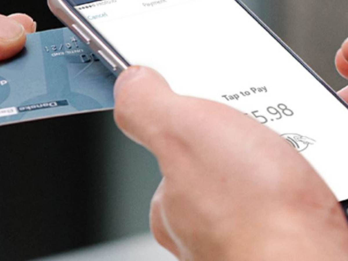 chip-enabled credit card near a smartphone