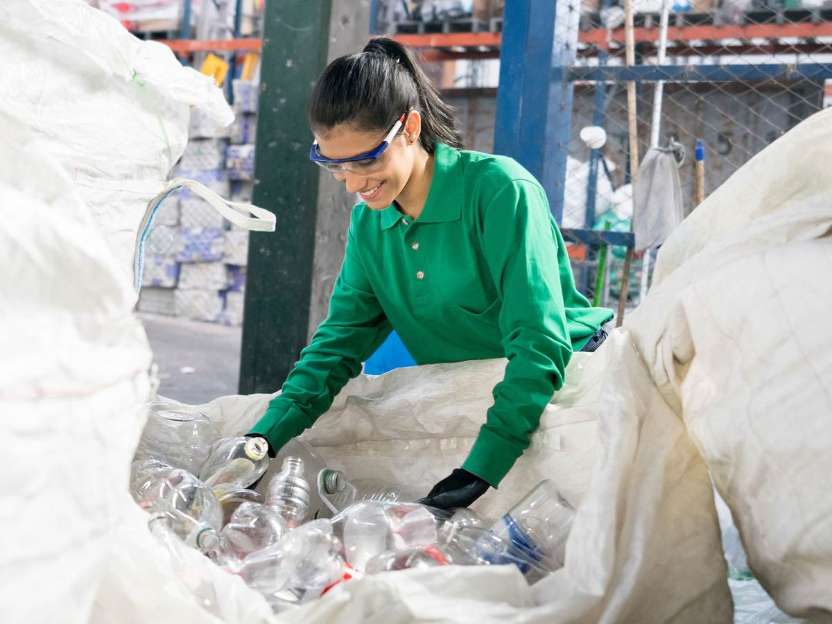 woman looking at plastic recycled bottles