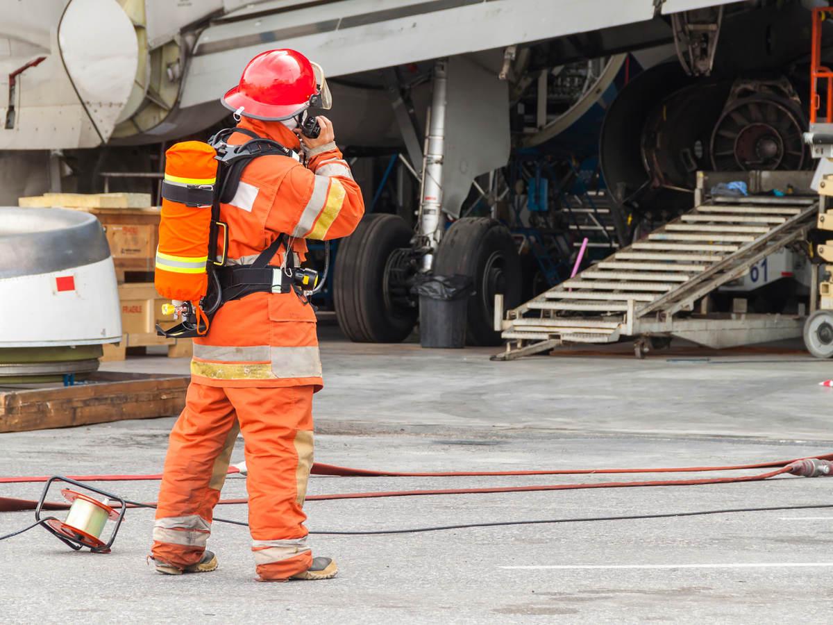 Firefighter communicating on radio