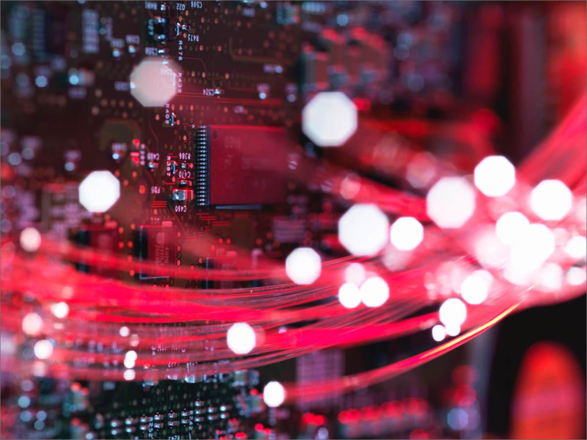 Close-up of fiber optics flowing through circuit boards