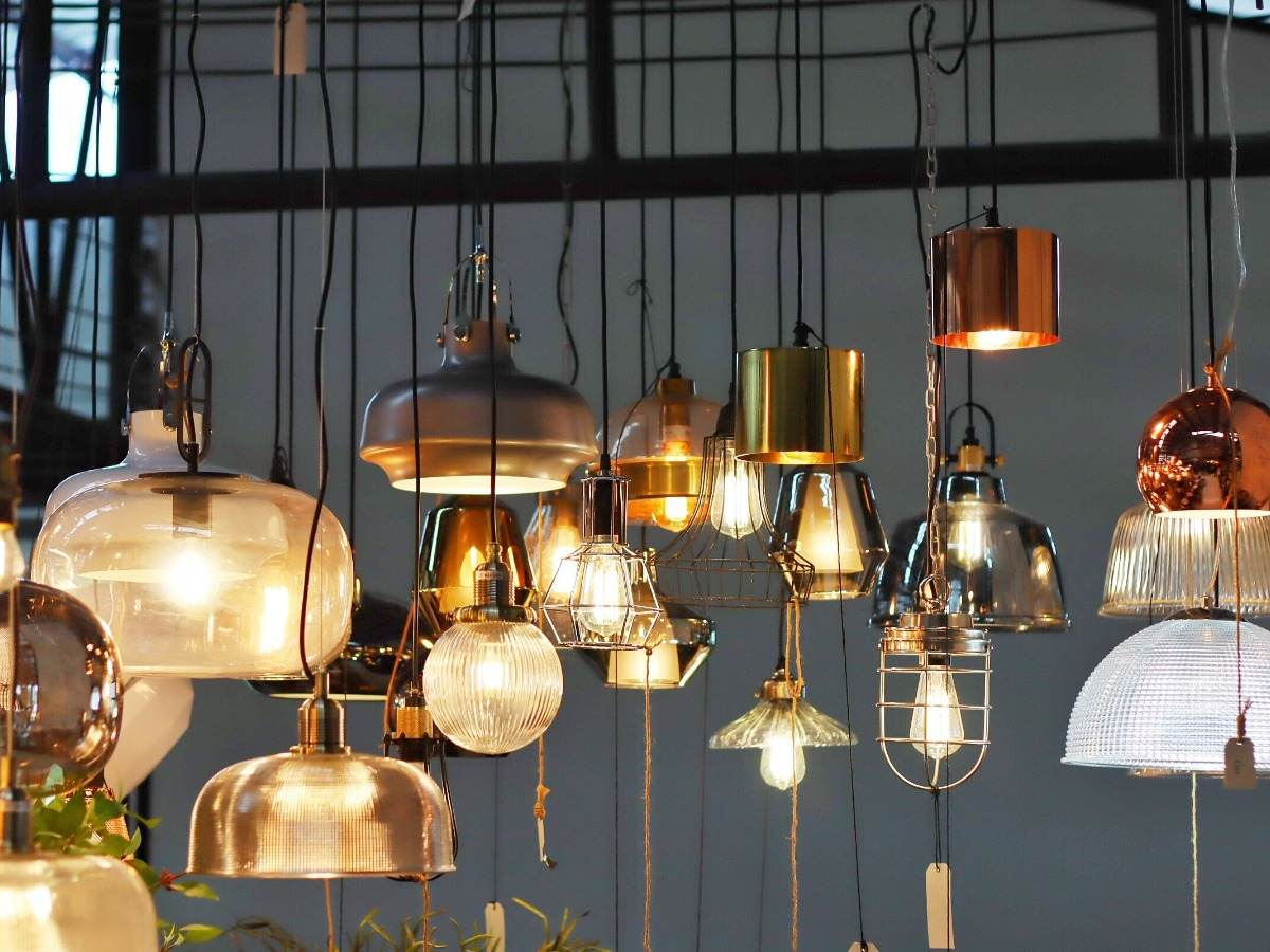 Variety of lamps and lightbulbs hanging from ceiling