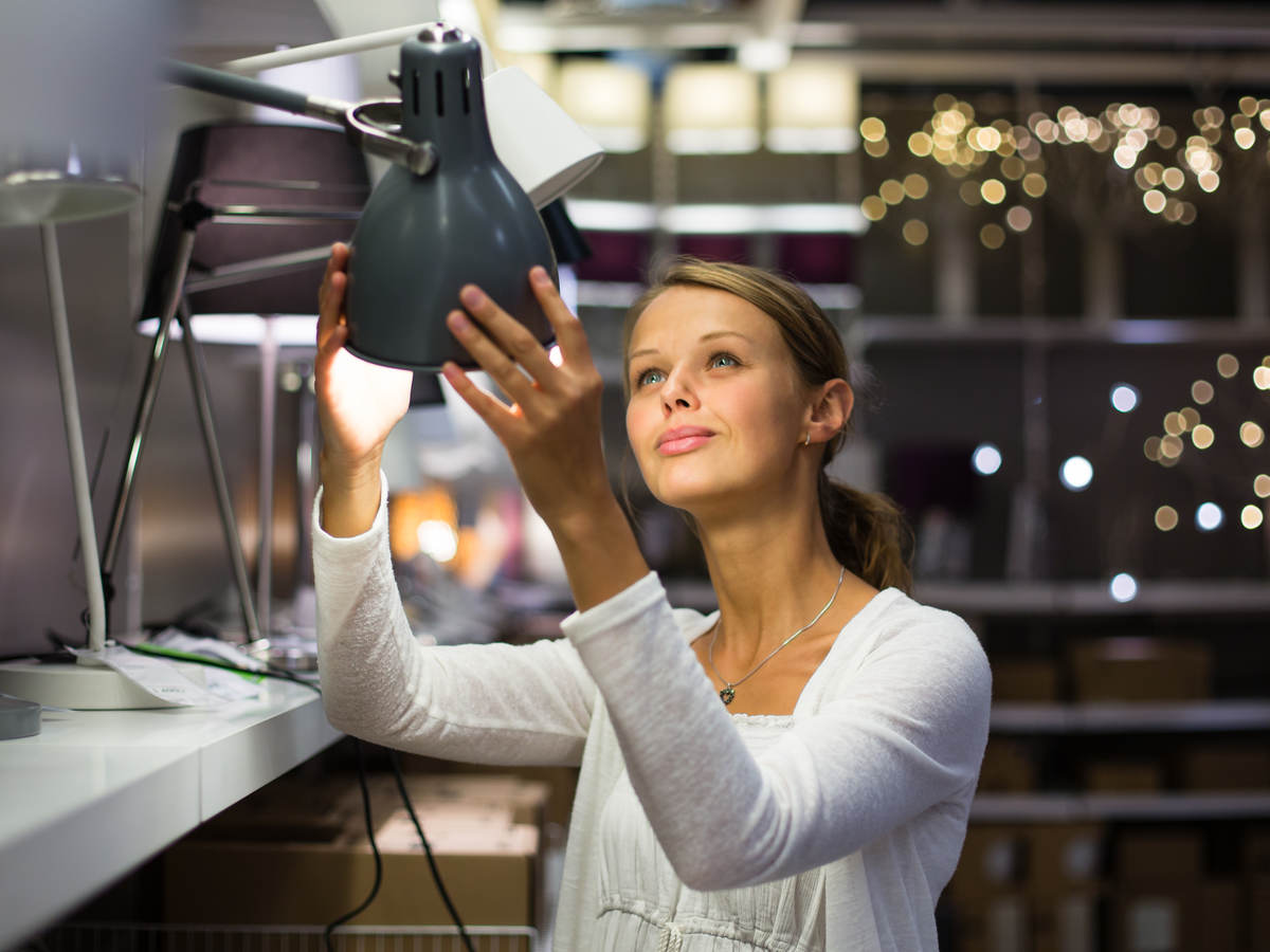 Women looking at desk lamps in a store