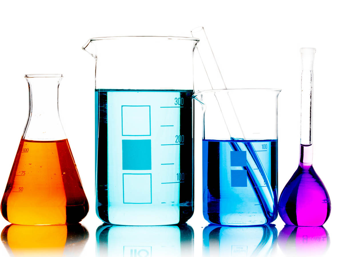Lab beakers containing different colored liquids