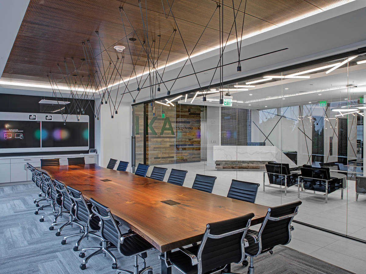 A conference table in a light-filled room