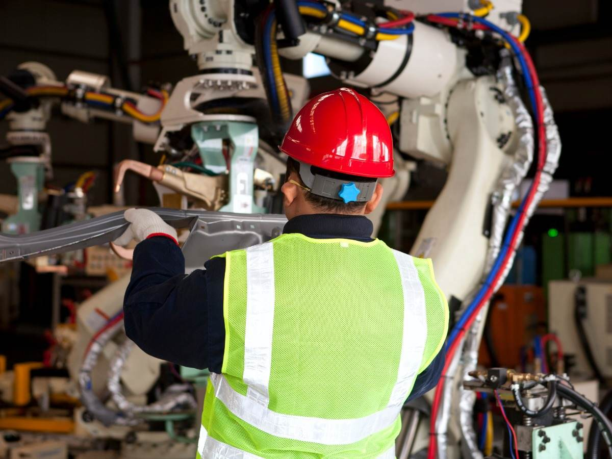 Operator in factory testing robot machine