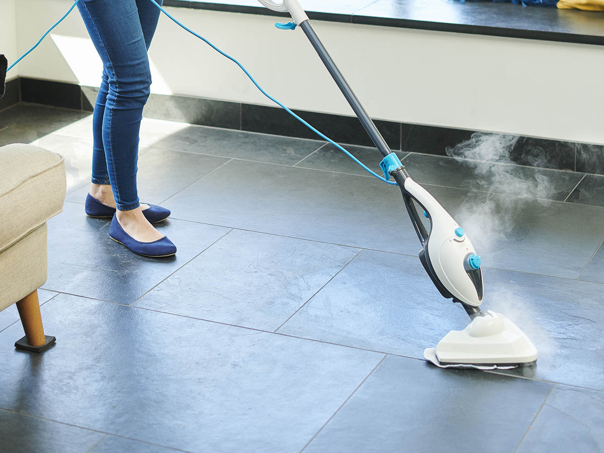 Steam cleaner mop cleaning a floor