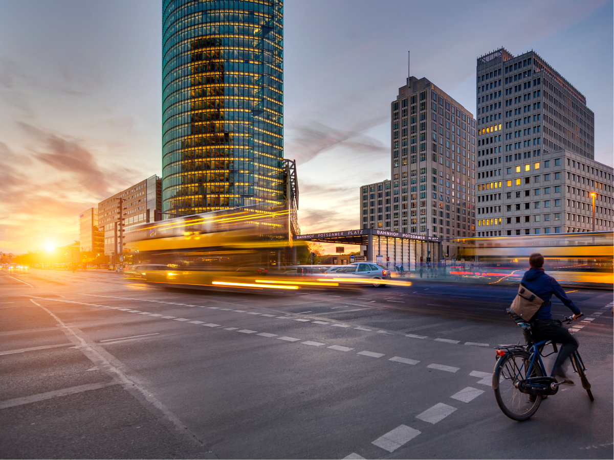 Person riding their bike in the city at dusk