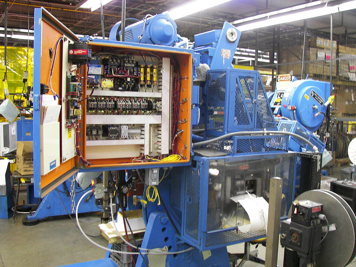 Industrial machinery with open control panel