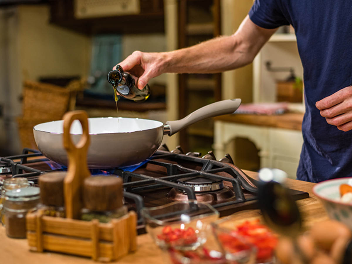 Man cooking on stove top.