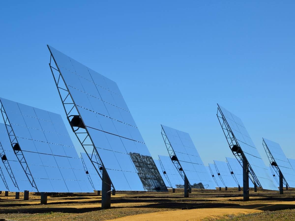 bifacial solar panels against a blue sky