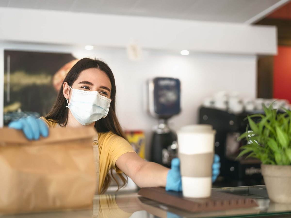 Foodservice worker following safety guidelines and wearing proper safety equipment