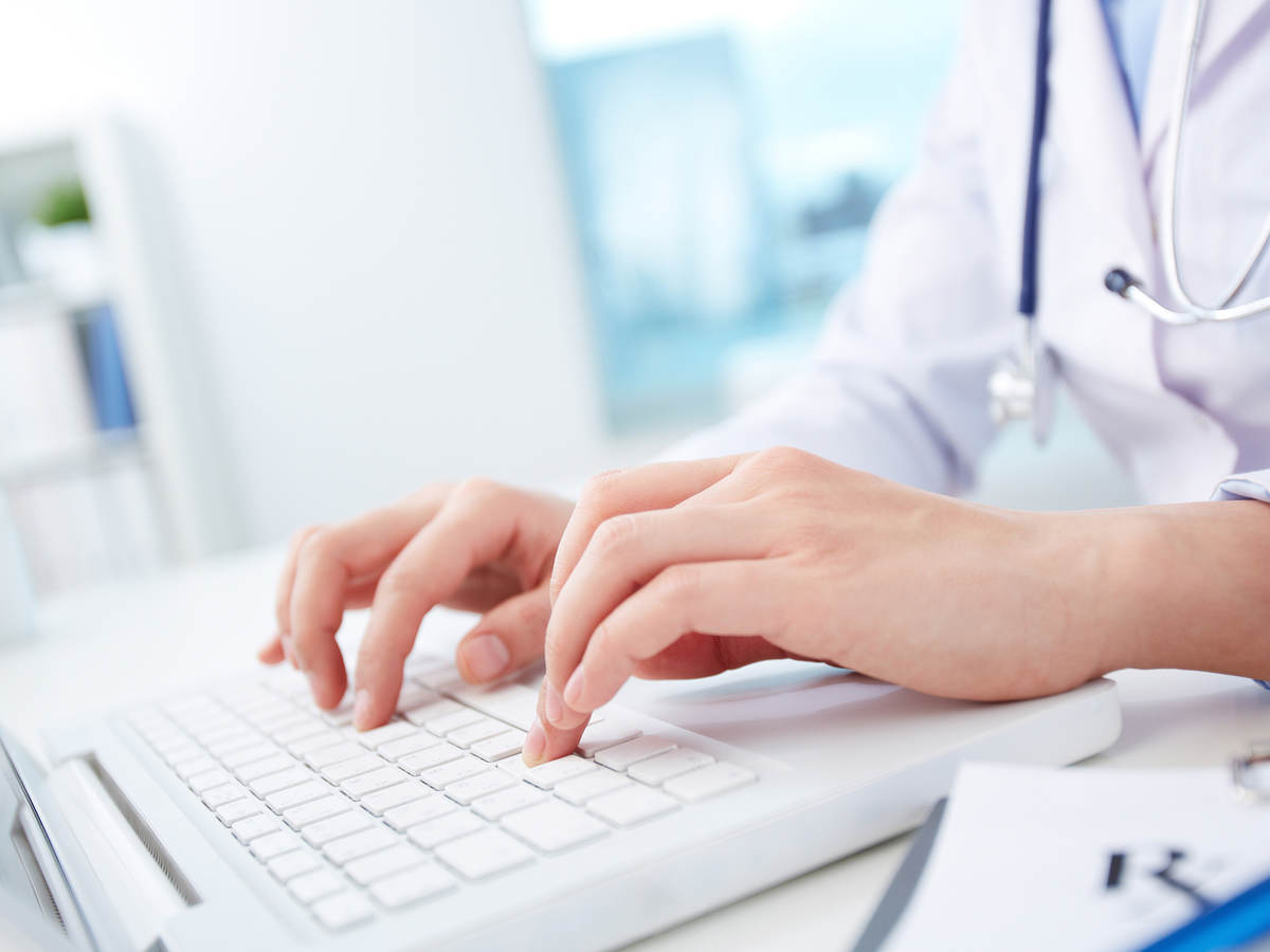Medical professional typing
