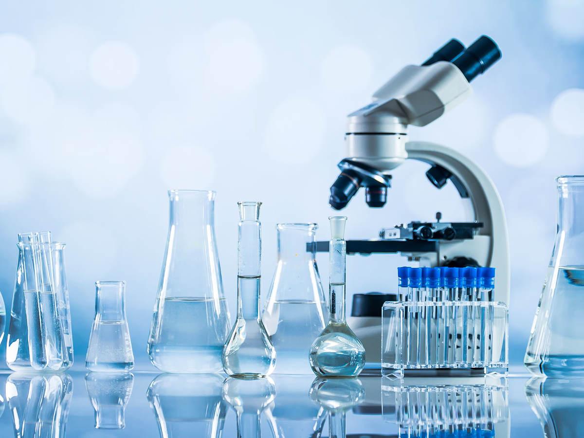 Microscope with glass laboratory equipment