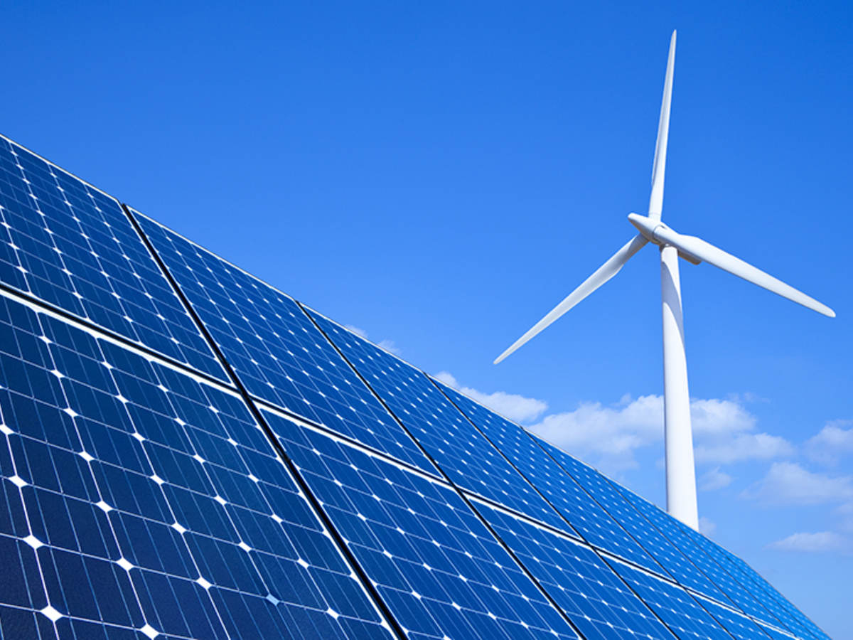 solar panels and wind turbine against a blue sky