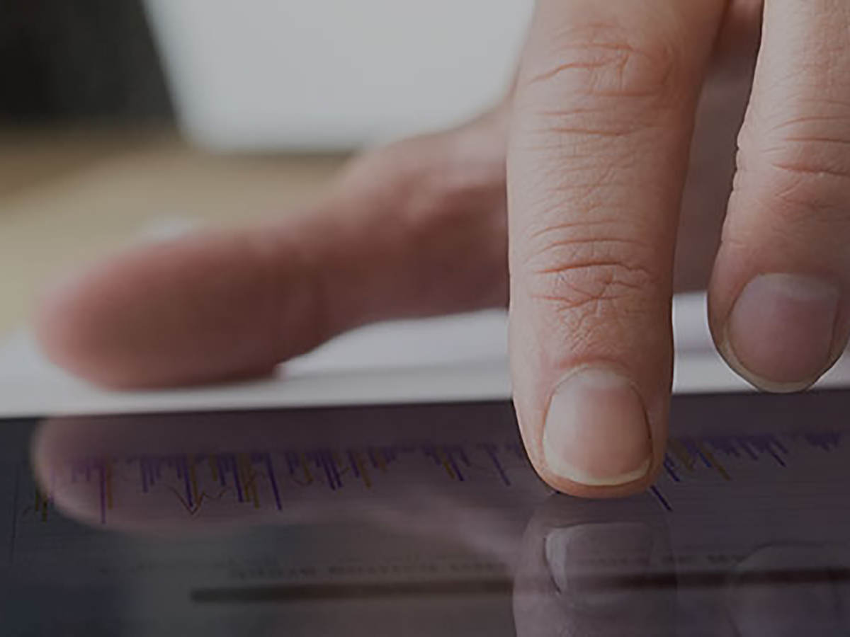 Person taking an online course and clicking on a graph on an ipad