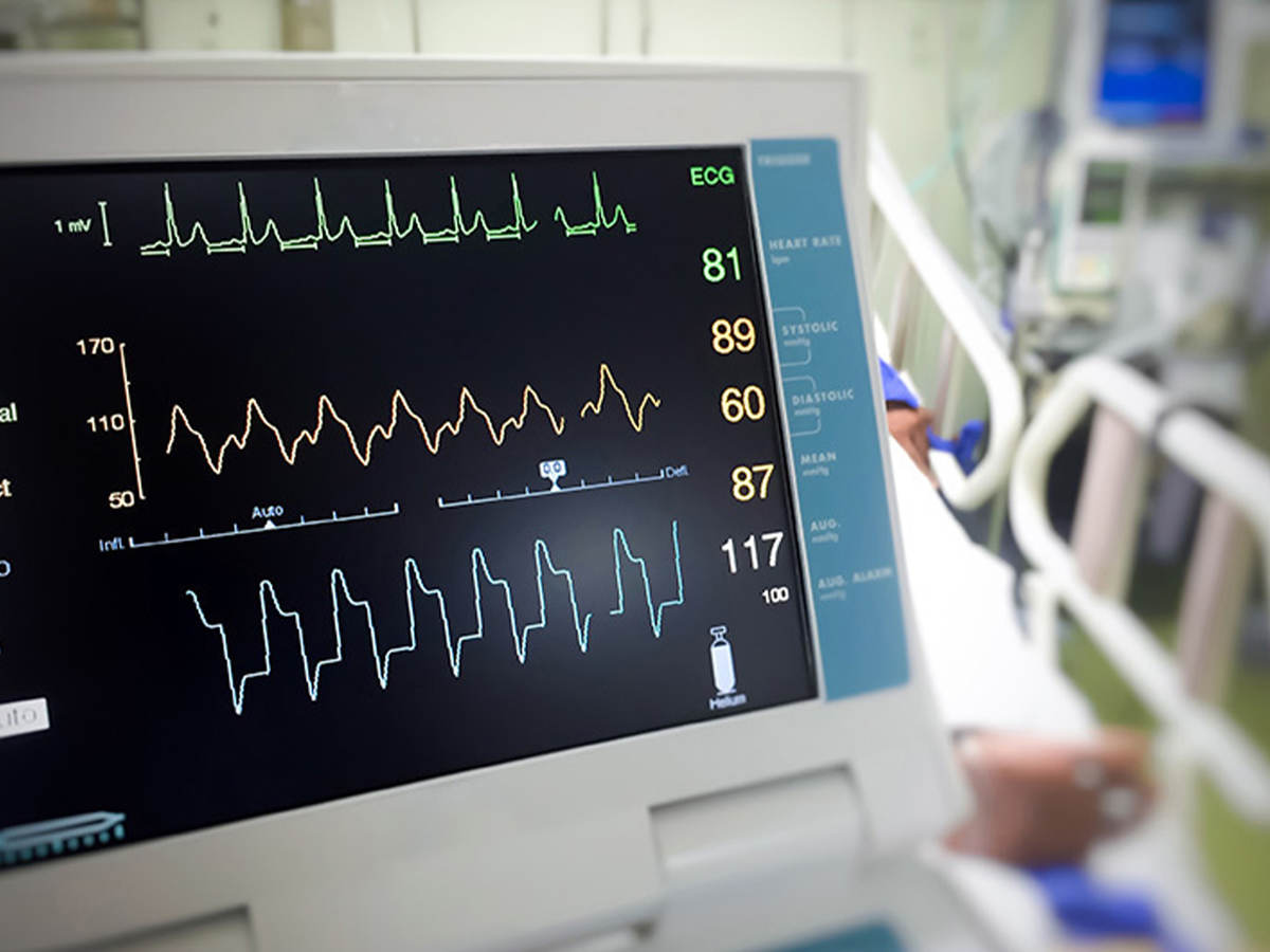 Close-up of an electrocardiogram monitor in a hospital room