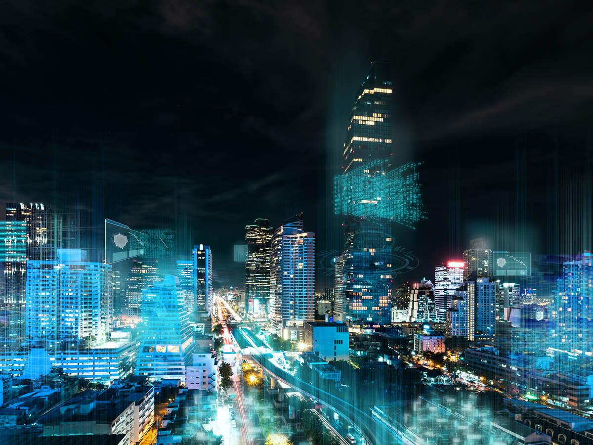 Modern city illuminated at night