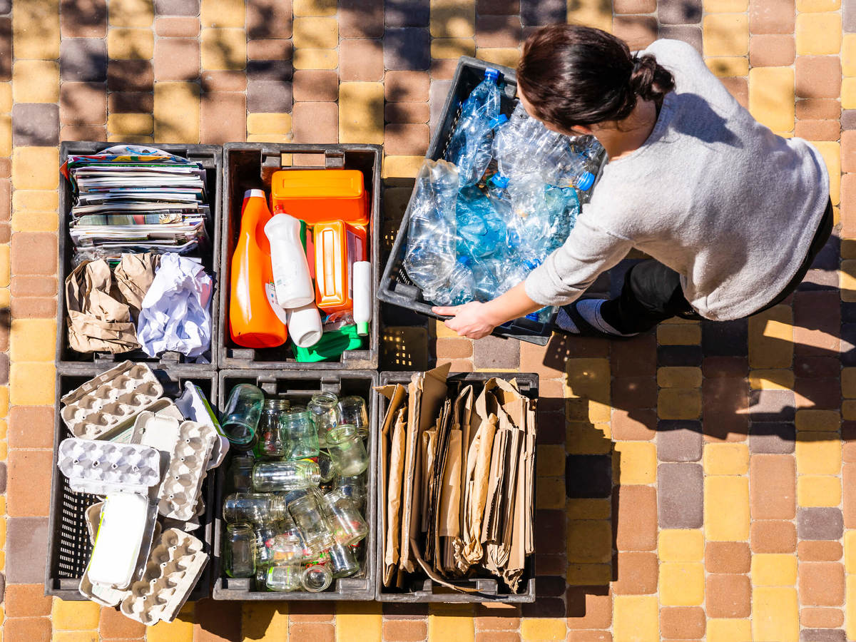 Woman sorts materials for recycling
