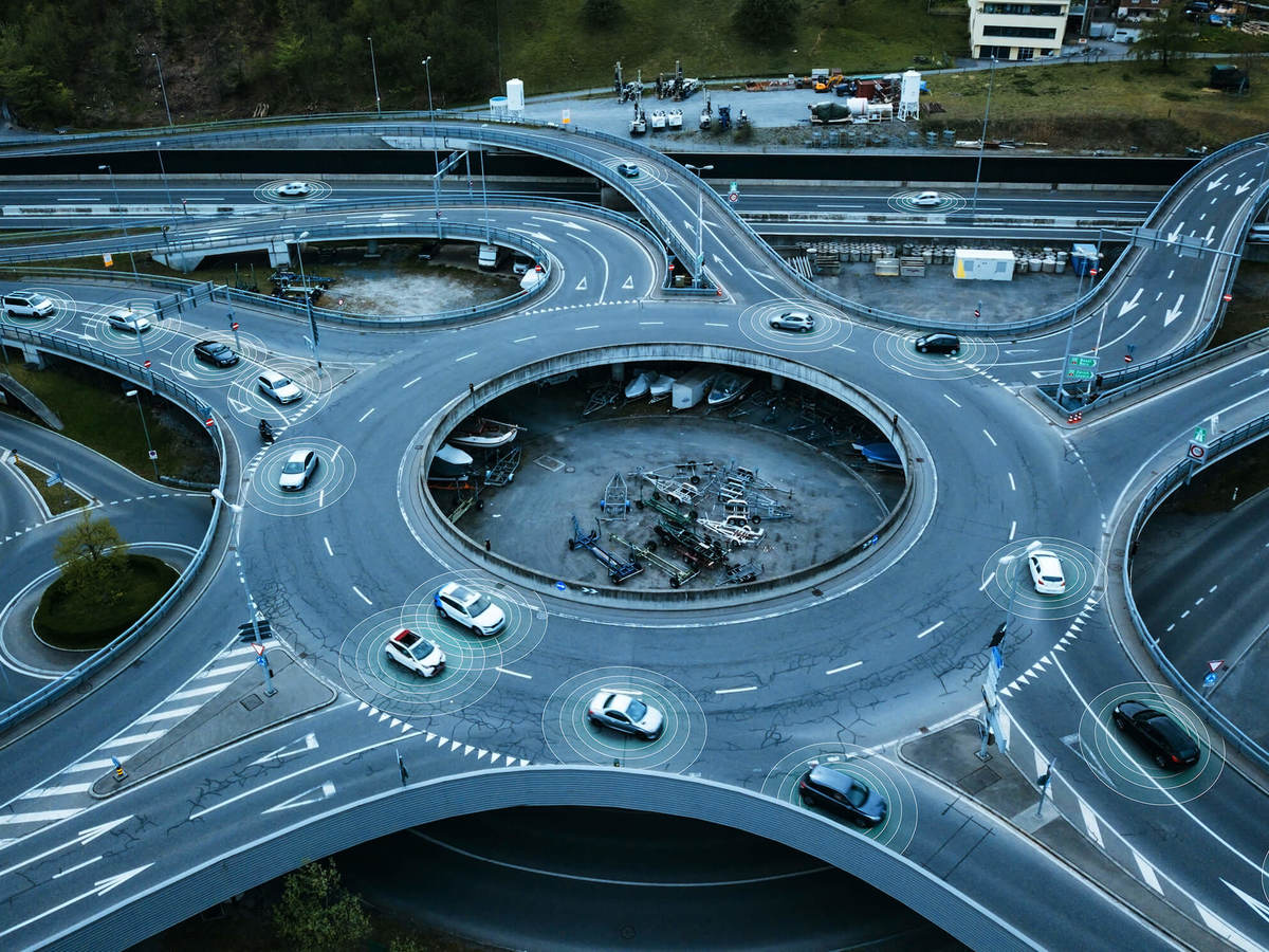 a complex roundabout filled with cars traveling to their destinations.
