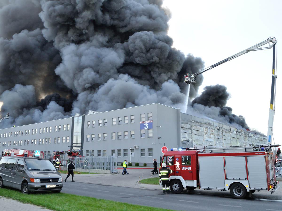firefighter crews battling storehouse fire