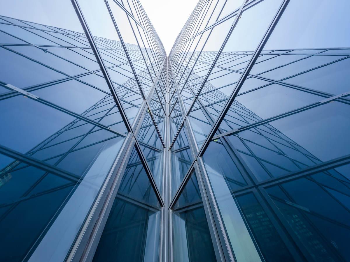 Modern blue glass building mirror reflections