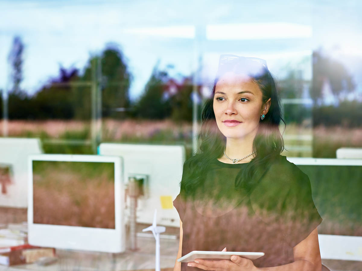 Woman looking outside a window at work