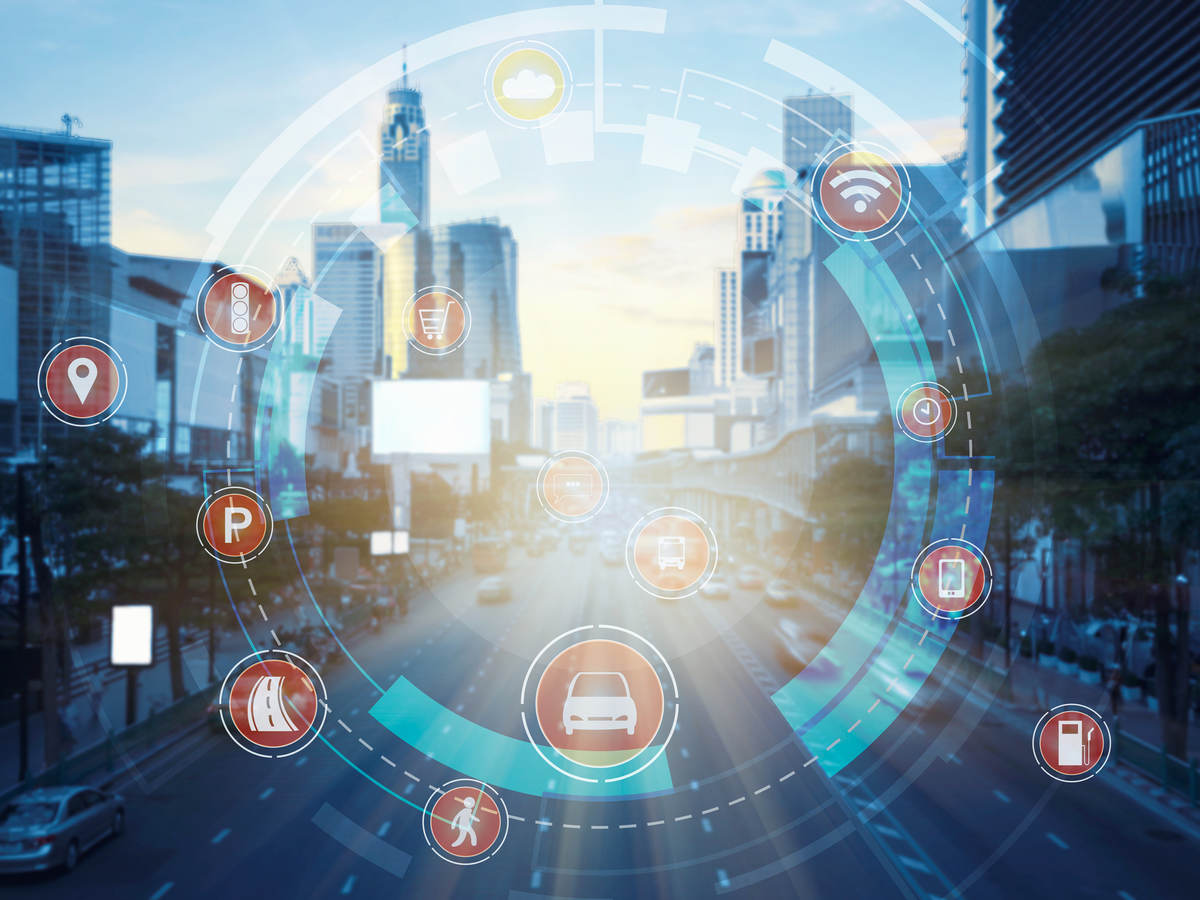 City street scene with technology icons in circular formation